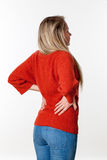 Backache, lumbago, scoliosis health problems for young woman. Backache, lumbago, scoliosis health problems - young blond woman having a back pain, massaging her Royalty Free Stock Image