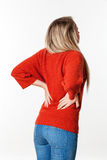 Backache, lumbago, scoliosis health problems for young woman. Backache, lumbago, scoliosis health problems - young blond woman suffering from back pain, touching Stock Image