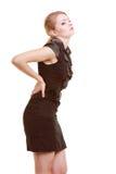 backache Młodej kobiety cierpienie od bólu pleców odizolowywającego obrazy royalty free