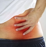 Backache, Pain in the lower back Stock Photo