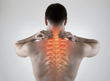 Backache. Sportsman with backache, gray background Royalty Free Stock Images