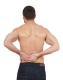 Backache. Sportsman with backache, white background Stock Photography