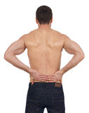 Backache. Sportsman with backache, white background Stock Images