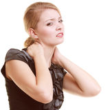 Backache. Young woman suffering from back pain isolated. Backache. Young businesswoman woman blonde girl suffering from back or neck pain isolated on white Royalty Free Stock Photos