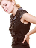 Backache. Young woman suffering from back pain isolated Stock Images