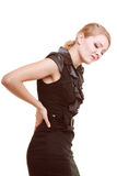 Backache. Young woman suffering from back pain isolated Royalty Free Stock Photo