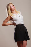 Backache. Young woman suffering from back pain Stock Photography