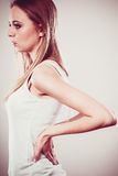 Backache. Young woman suffering from back pain Royalty Free Stock Photo