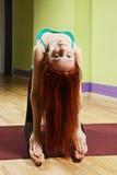 Backbend pose hands on feet. Backbend yoga pose pose hands on feet Stock Photo