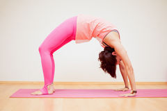 Backbend pose in a yoga studio Stock Images