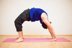 Backbend pose by a young man Stock Photography