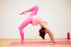 Backbend with raised leg yoga pose Stock Photos
