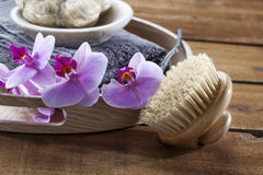 Backbrush and loofah for skin beauty with femininity. Beauty ritual for spa treatment with natural sponge, towel, brush, loofah, flowers and massage accessory Stock Photo