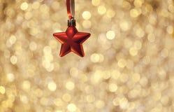 Backcgound dourado com estrela Imagens de Stock