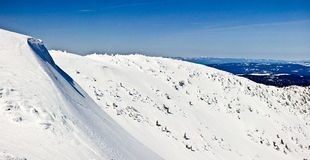 Backcountry Mountain Slopes. A snow covered slope in the back country of canada's mountains making it prone to avalanches and other dangers of winter Stock Photos