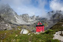 Backcountry ski hut in the Talkeetna Mountains, Alaska. Backcountry ski and backpacking hut in the Hatcher Pass wilderness area in the Talkeetna Mountains stock photos