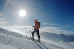 Backcountry skier. A lonely backcountry skier in snowstorm, horizontal orientation royalty free stock photos