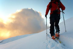 Backcountry skier. Walks in the snow at sunset, italian alps, europe royalty free stock image