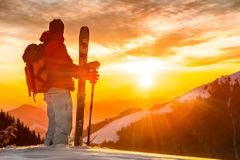 Backcountry skier standing on top of the mountain  to watch the Royalty Free Stock Images