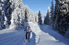 Backcountry skier touring in beautiful winter mountains Stock Photo