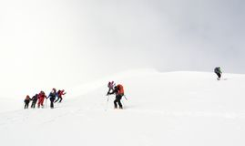 Backcountry skiers ascending a mountain Royalty Free Stock Image