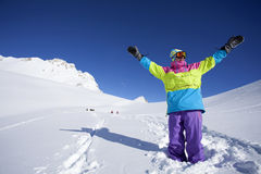 Backcountry snowboarder hiking to summit. Snowboarder in backcountry hiking to the summit royalty free stock photo