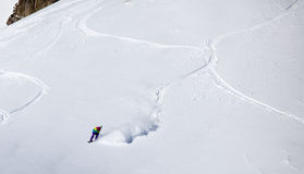 Backcountry snowboarder riding fresh powder Stock Photo