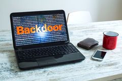 Backdoor. A software backdoor on a laptop computer stock photography