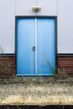Backdoor. Unused blue backdoor of a warehouse royalty free stock photos