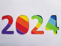 Number 2024 with foamy in rainbow colors and white background. Backdrop for ads related with multicolors, new year celebration, creative design, diversity and royalty free stock photo