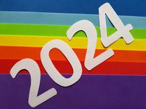 Number 2024 in white with foamy in rainbow colors background. Backdrop for ads related with multicolors, new year celebration, creative design, diversity and stock image