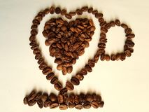 coffee beans roasted to forming a heart cup stock photography