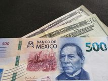 banknote of 500 mexican pesos and twenty five dollars in american bills stock photography
