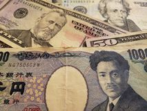 japanese banknote of 1000 yen and american dollars bills, background and texture stock photo