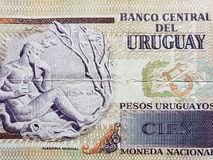 Approach to uruguayan banknote of 100 pesos. Backdrop for announcements of trading and exchange, bank and commerce, price of buy and sell, cash value and money stock photos