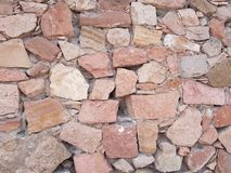 Stone surface in pink colors for outdoor and interior decoration. Backdrop for architectural and construction industry announcements, retro style and design stock image