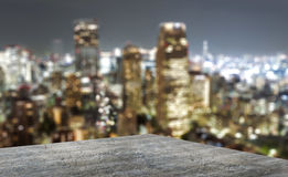Backdrop of a big city at night. With a roof terrace Royalty Free Stock Photo