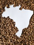 Map of Brazil in white and background with roasted coffee beans. Backdrop for cafeteria and coffee products, agriculture and harvest, seeds with flavor and aroma royalty free stock images