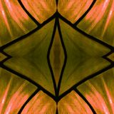 Approaching the stained glass in orange and brown colors, with symmetry and reflection effect, background and texture. Backdrop for color ads, creative pattern royalty free stock image