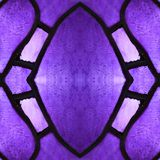 Approaching the stained glass in purple colors, with symmetry and reflection effect, background and texture. Backdrop for color ads, creative pattern and stock photo