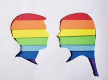 Silhouette of a male and female head in rainbow colors and white background. Backdrop for colors ads, lgbt community and diversity rights stock images