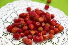 Wild strawberry on a lace napkin background Royalty Free Stock Images