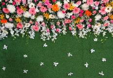 Backdrop flowers arrangement on turf for wedding ceremony Stock Photography