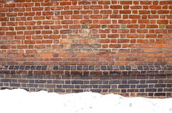 Backdrop of grunge red brick wall and snow winter Stock Photo