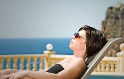 backdrop lady mediterranean sunbathing Στοκ φωτογραφία με δικαίωμα ελεύθερης χρήσης