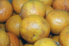 Backdrop of many orange. it is a round juicy citrus fruit. Backdrop of many orange. it is a round juicy citrus fruit with a tough bright reddish-yellow rind stock image