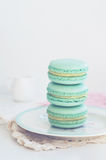 Backdrop with mint macaroon on light background Royalty Free Stock Photography