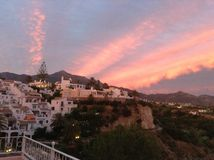 Backdrop of Nerja Spain during sunset. Royalty Free Stock Photos