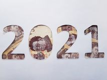 Number 2021 formed with mexican banknotes on white background. Backdrop for new year and cash announcements, date and event in calendar, economy and finance Stock Photos
