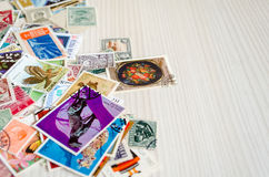 Backdrop of old postage stamps Stock Images